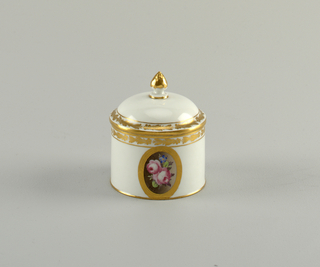 Cylindrical, domed cover. Floral medallion, gilded bands.