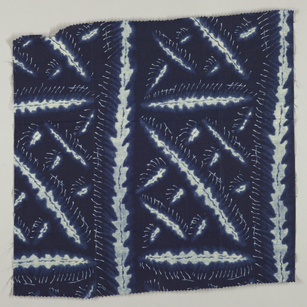 Blue and white herringbone-style pattern with large squares.