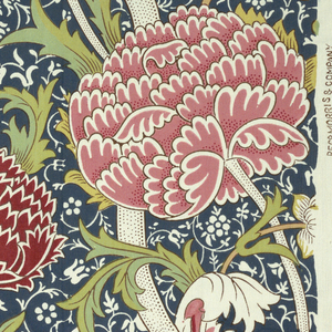 Large-scale design of exotic flowers with curving stems and leaves, large flowerheads suggesting tree-peonies and lotus in pink, red, yellow, and white with brown outlining on a ground of dark greenish-blue with fine, small-scale all-over reserve pattern of scrolling stems, leaves and flowers.