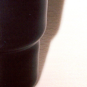 Nearly transparent purple glass stepped cylindrical tumbler.