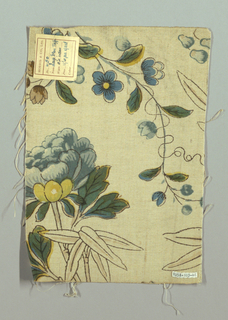 Medium-scale floral in the Chinoiserie style, with foliage including bamboo and tree peony, in blues, greens, yellow and tan with balck outline on a cream ground. Narrow plain selvedge with double warps.