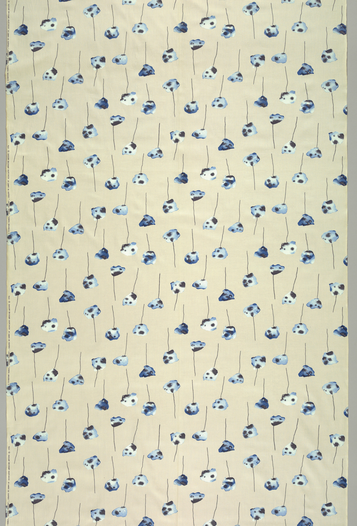 Abstract poppies with blue, black and white in each poppie, on beige fabric.