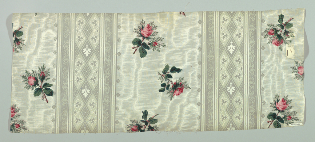 Ground printed in grey in alternate stripe pattern; one stripe, molette printed in moire effect, is over-printed with scattered rose clusters in pinks and greens. Alternate stripe, probably roller printed, consists of symmetrical pattern of stylized floral motifs and diamond shapes.