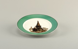 Circular plate with wooden church painted in center (tall conical dome), wide green border edged by thin black lines