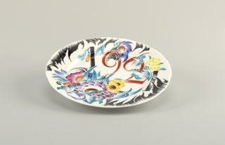 "Circular, slightly shaped edge; the inscription ""1921"" intersperced among stylized floral motifs"