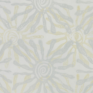 Large-scale sunburst motifs with a spiraling center. Printed in pale blue and tan on a hand-painted backgound of light blue.
