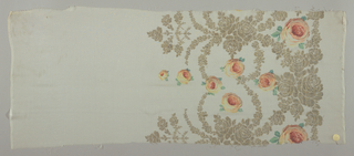 Sample of a solid off-white ground has a wide border design of printed yellow-orange roses and green leaves with swags, garlands, and spires in brocaded gold thread.