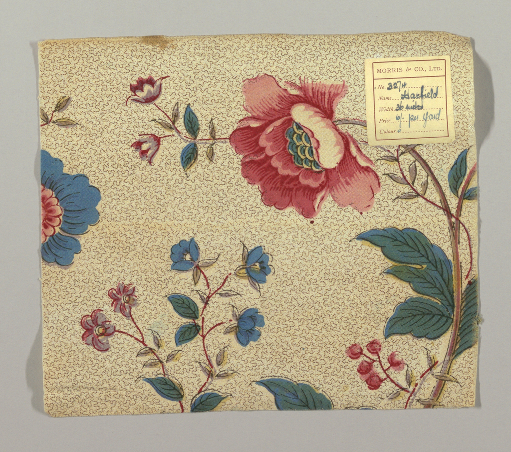"""Morris & Company textile in the """"Hatfield"""" pattern. Chinoiserie flowers in bright green, blue, pink, yellow, and mauve. Flowers outlined in red and black on a beige ground covered with a meandering dotted line pattern."""