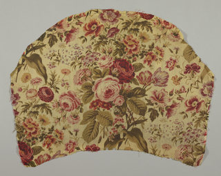 Fragment cream colored wool, twill weave; semicircular in shape, printed in shades of red, yellow, olive green, drab, violet. Naturalistic cluster of roses, tulips, etc. Probably roller print with overprint by block. Left selvage present.