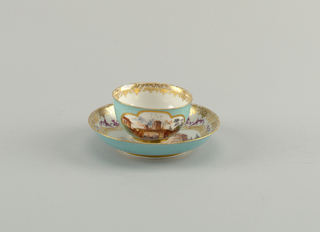 "Cup hemispherical, with slight outcurving at edge; cylindrical foot; no handle. Saucer shallow, curved side, slight outcurving at edge. Outside of cup and saucer decorated with slightly mottled red-violet, in which on cup are two four-lobed reserve panels enclosing seaport scenes. Upper face of saucer decorated with seaport enclosed in framework of gilding and colored scrolls. ""Lace"" borders in gilding. Inside of cup has small landscape decoration."