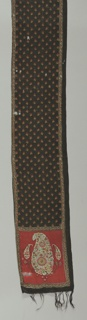 Fine printed wool scarf; fringed at ends; black background in body of scarf; red background at ends; polychrome print in persian cone pattern; one long edge hemmed.