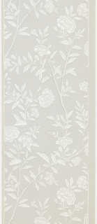 Ascending serpentine branches with leaves, buds and large blossoms. Very long vertical repeat. Drop match. Printed in white and dark gray on light gray ground.