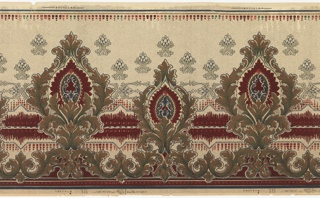Alternating large and small acanthus medallions. Deep red band just below center connects all medallions. Small floral motifs in upper portion. Printed on spotted background.