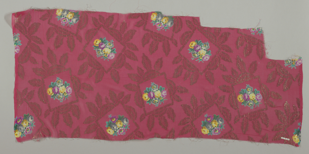 Sample of solid red georgette crepe with silver brocaded leafy frames containing a small-scale bouquet of roses printed in multicolor. Both selvedges present.