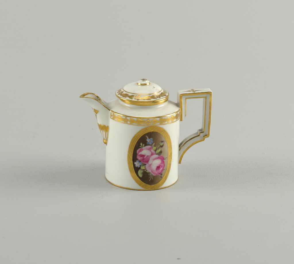 Cylindrical, domed cover. Slight concave lip; strap handle of rectangular form. Oval floral medallions, gilded bands. Bottom unglazed.