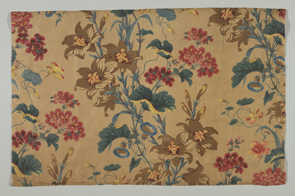 Large flowers in bright colors on a ground of pin-dots. Printed in brown, blue, yellow and red.