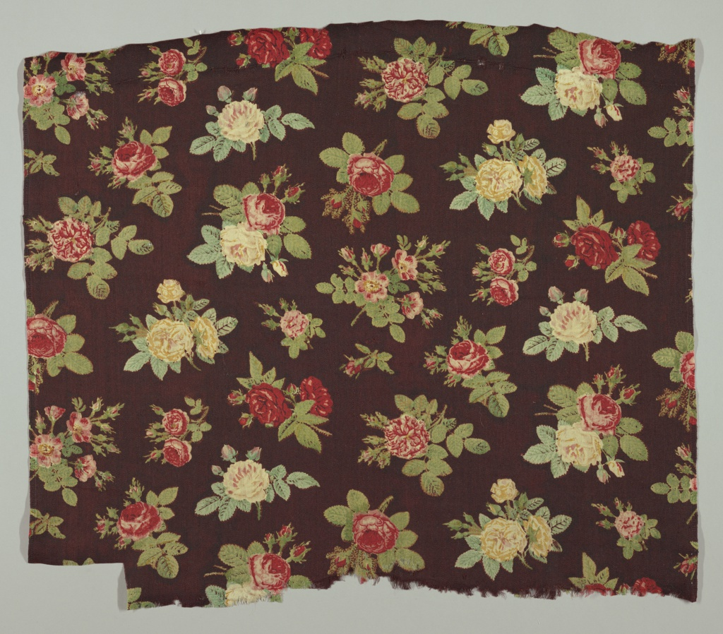 All-over pattern of regularly spaced roses of various sizes in reds, yellows, and greens on a deep maroon background. Half-drop repeat.
