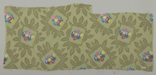 Sample of solid yellow-green georgette crepe with silver brocaded leafy frames containing a small-scale bouquet of roses printed in multicolor. Both selvedges present.