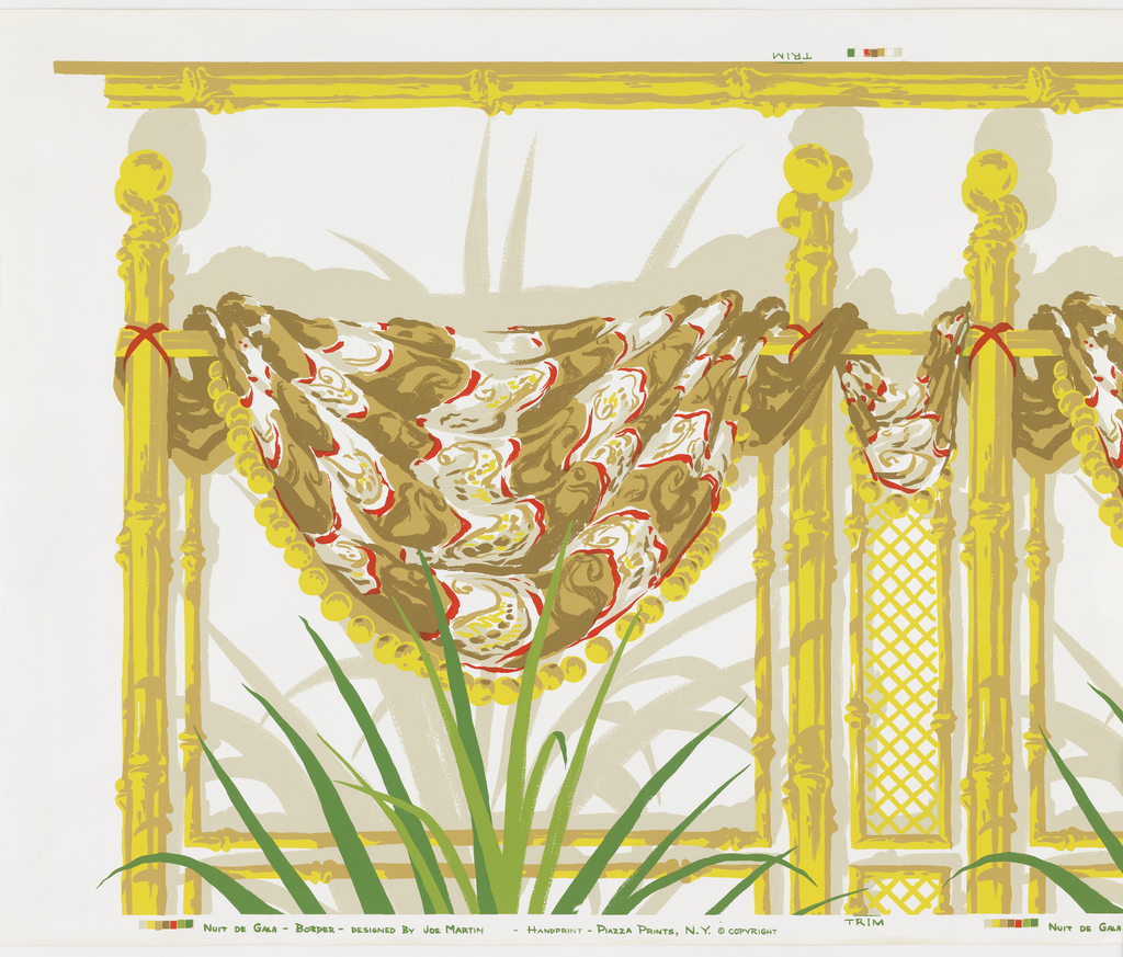 Drapery swag suspended on bamboo support, with palm fronds and latticework.