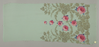 Sample of a solid pale green ground has a wide border design of printed pink roses and blue leaves with swags, garlands, and spires in brocaded gold thread.