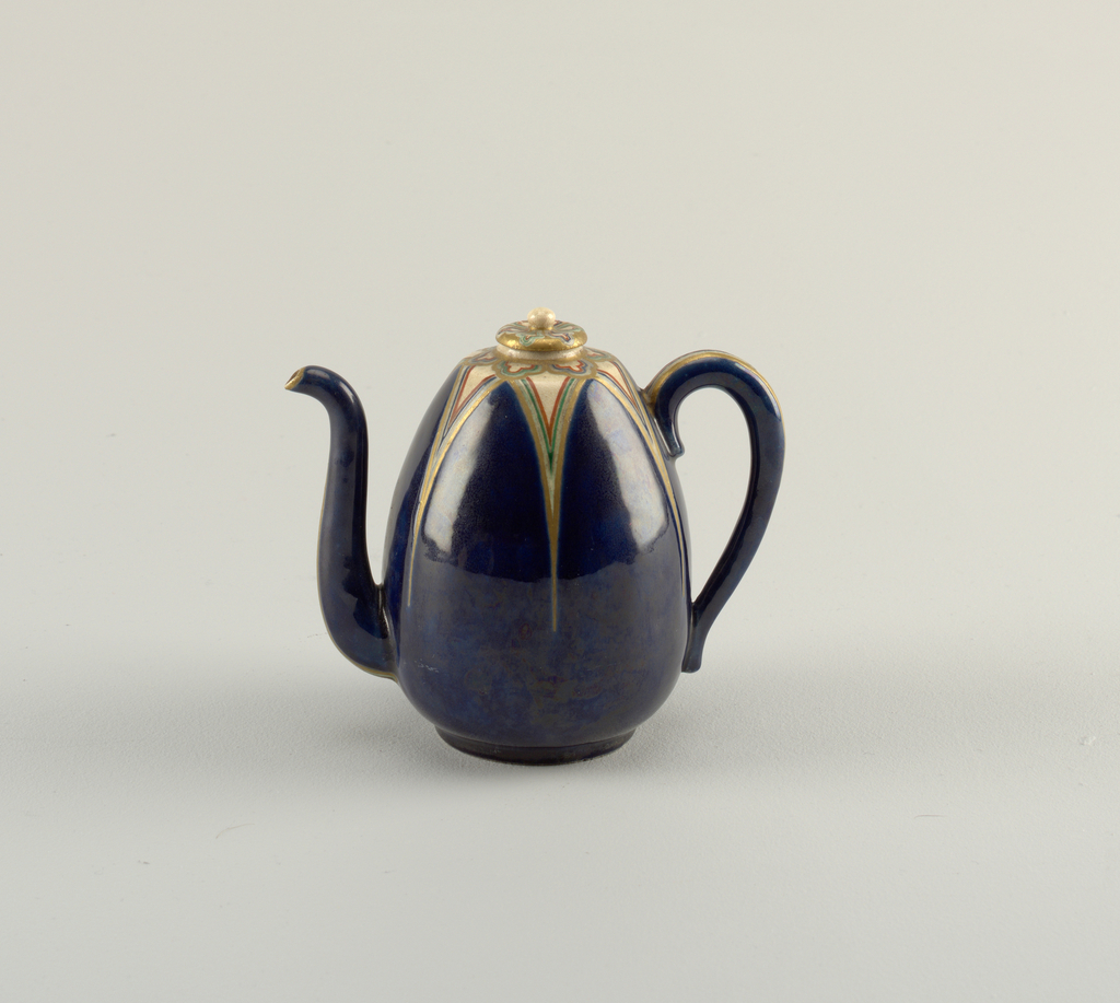 """Ovoid shape. Curved spout and loop handle. Clear crackle glaze on buff body. Deep blue enamel in form of six petal-like sections on shoulder, outlined and decorated with """"jui-i"""" forms of gold, green, blue, red. Gold lines on underside of spout and handle. Underside of foot glazed. Stopperlike cover with similar """"jui-i"""" design on gold reserve. Round knob."""