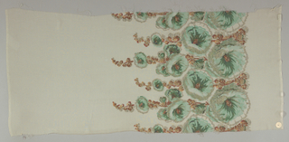 Sample of off-white georgette crepe has a wide printed border of green hollyhocks and light brown leaves with brocaded silver thread details.