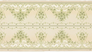 Printed two across, frieze features horizontally repeating, delicately rendered floral sprays with symmetrical foliate scrollwork. The sprays run along the top and bottom edges of the panel, and mirror each other across a central divider of two thin lines with beaded borders and scalloped floral garlands. A small area of vertical lines extends from both the top and bottom edges of the panel. This design is rendered in shades of green and white on a beige background.