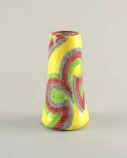 Round vase with wider base colored in yellow, blue, purple, and green in scalloped pattern.