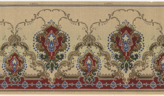 Horizontal repeat of alternating large and small vegetal medallions surrounded by rococo inspired borders of foliate c scrolls and blue, beaded garlands. The bottom edge of the panel is bordered with a row of highly stylized blue blossoms, and the top of the panel is bordered by plain brown and blue stripes. An allover pattern of tiny, interlocking dots gives the panel the appearance of a cross-stitched embroidery. This design was printed in shades of dark red, green, blue, brown and gray on a beige ground.