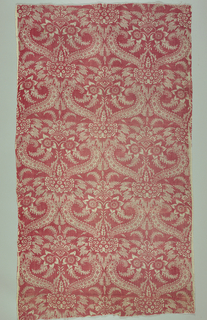 Center line design of flowers and strapwork. Pattern reserved (white) on printed red.