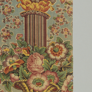 Chintz fragments in a pillar design. Green-blue ground and pillar in shaded brown stripe effect with foliage and large flower clusters in shades of red, rose, yellow and green. Green color is produced by printing blue over yellow.