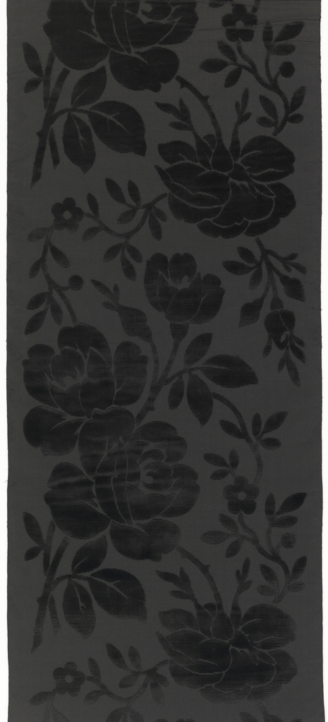 Sample of a wide ribbon with a black taffeta ground with a black cut velvet design of realistically-drawn climbing rose sprays.