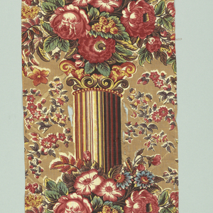 Long, narrow fragment printed in a pillar design. Brilliant natural size flowers clustered on pillar, which is striped in deep red, brown, yellow, and light red. At side, small clusters of flowers. Ground in tea-color brown.