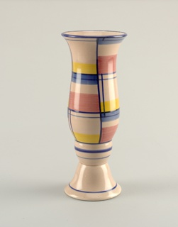 Tulip-shaped cylindrical vase rising from a circular base.  Pale rose ground color with lines of blue on rim, base, and where body joins the base.  Lines of royal blue also divide the surface into a pattern of swatches of bright rose, yellow, and blue.