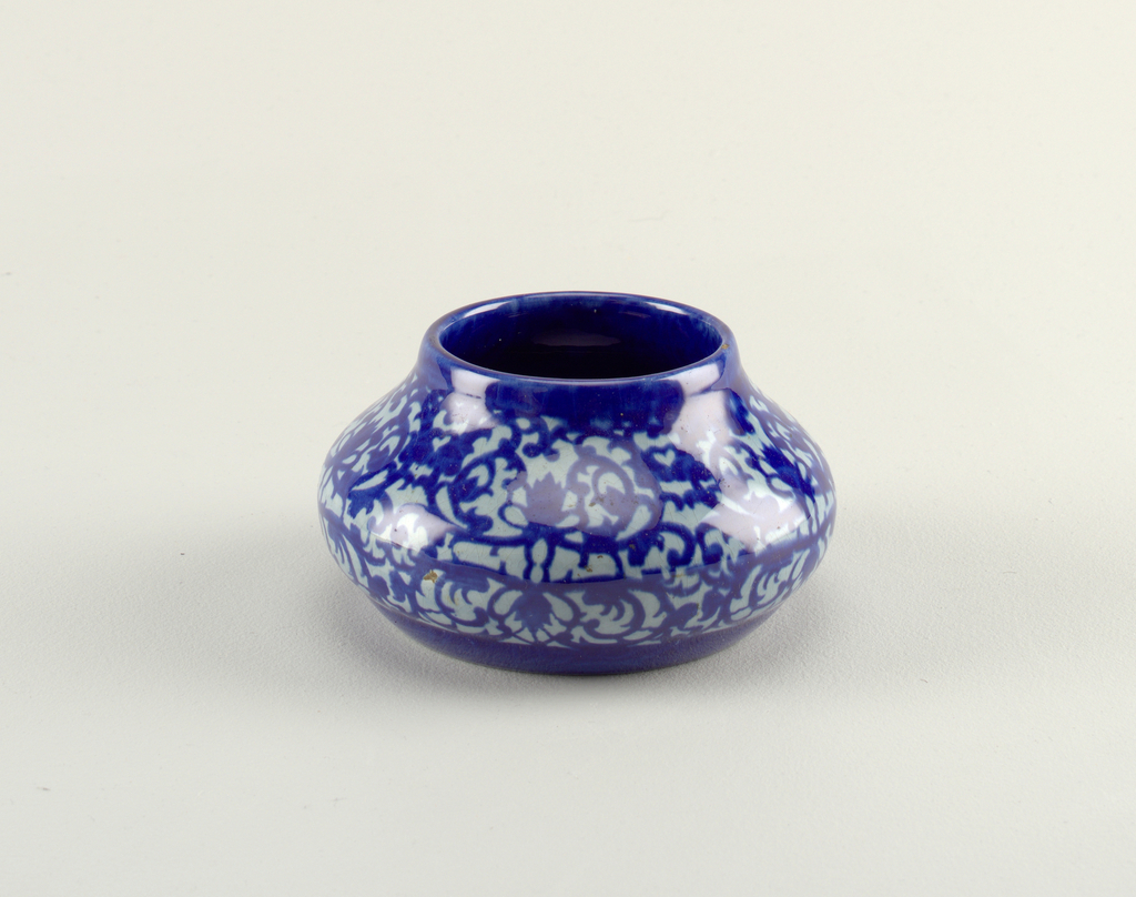 Ovoid vase with low neck and no lip. Blue pomegranate pattern glaze.