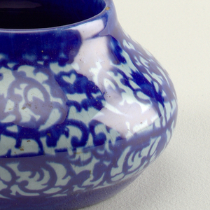 Ovoid vase with low neck and no lip. Blue pomegranate pattern glaze.