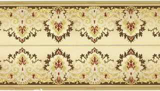 Printed two across. Very frilly pattern of medallions, alternating larger and smaller. Printed on tan ground.