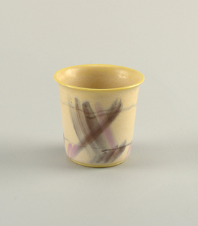 Vase with flared lip, rim in yellow, decorated with black and pink brushstrokes.