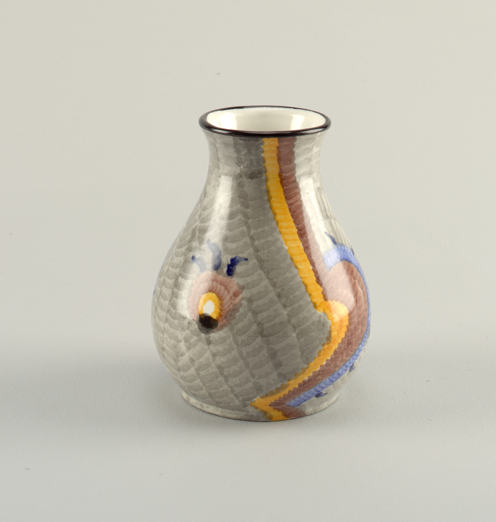 Circular, bulbous body wide at the bottom narrowing to the top with a slight flare out at the lip.  Interior glazed white.  Gray exterior ground color patterned with abstract shapes: two snail-like forms running from the rim to the base in yello, brown, and blue and two circular shapes in blue, yellow, brown, and white.  Also, a black line around the rim.