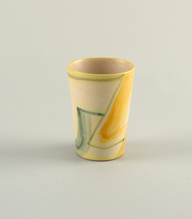 Straight slightly flared beaker decorated around object brushed lines in green and yellow.