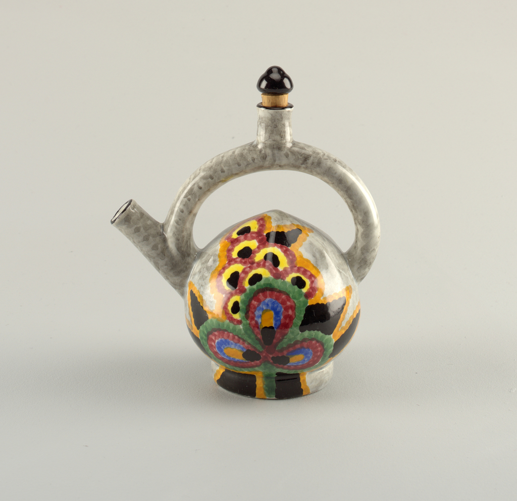 Spherical body with offset round base.  Rising round spout.  Semicircular handle joined at spout and to body with a perpendicular rising cylinder at center of handle where cork stopper with a black glazed finial fits.  Body with mottled gray ground with spout and rising cylinder lined in black.  Hand painted design on either side of body with an abstract flower in black, orange, yellow, blue, burgundy, and green.