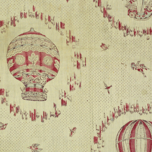 Two different balloons arranged in vertical stripes as an offset pattern. Both balloons have baskets carrying passengers and are probably after contemporary prints of balloonists. Picottage background with scattered birds and butterflies. In black, two reds, lavender and blue.