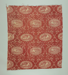 A reserve print. Design of lozenges containing male and female sea god figures. In red on natural.