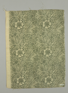 Close set vertical columns of serpentine stems with flowers and bunches of leaves, on a ground of smaller flowers, leaves, and scattered dots. In natural on a dark yellow-green ground. Wide plan selvedges in natural-color cotton.