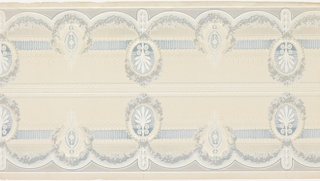 Borders printed two across (mirror). Alternating high and ow medallions printed ni blues, whites and greys. The high medallions have palmette center-pieces and the low medallions have beading and diamond patterns suspended from which are three stylized fleurs de lys. Connected the medallions are floral swags and beading/margent pattern. Top bands of wave & dot and bead & spindle patterns. The center has horisontal bands of short vertical lines, geometric shapes and leafy patterns. Cream ground.