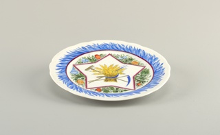 Circular, with shaped edge; in the center a star-shaped panel with wheat- sheaf, rake, sythe, pitch fork, sickle, surrounded by stylized vegetation; a border of blue suggesting cornflower petals