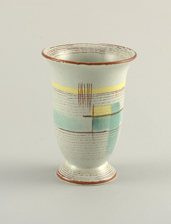 Flaring vase on a spreading foot. Grey ground decorated with thin russet lines and larger geometric pattern in green and yellow.