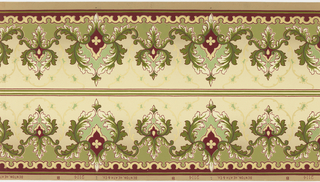 Printed two borders across the width. Alternating larger and smaller acanthus medallions. larger has red center with quatrefoil. Each medallion has a foliate scroll surround with green insers. Printed on tan ground.