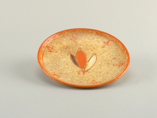 Circular concave plate with raised bottom rim.  Speckled brown background with orange edge bordered on the interior by a line with sprouting abstract orange oval blossoms.  Centered design of a three-lobed bloom of brown, orange, and white (from left to right), outlined in orange with an orange stem.