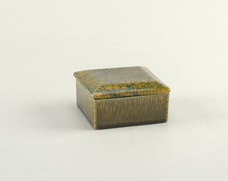 Square box with stepped lid. Orange and blue glaze painted to resemble crazing.